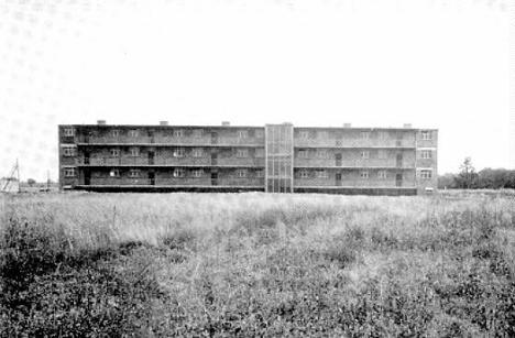 Erweiterung der Siedlung Dessau-Törten, Laubenganghaus, Entwurf: Hannes Meyer und Bauabteilung Bauhaus Dessau, 1929–30.