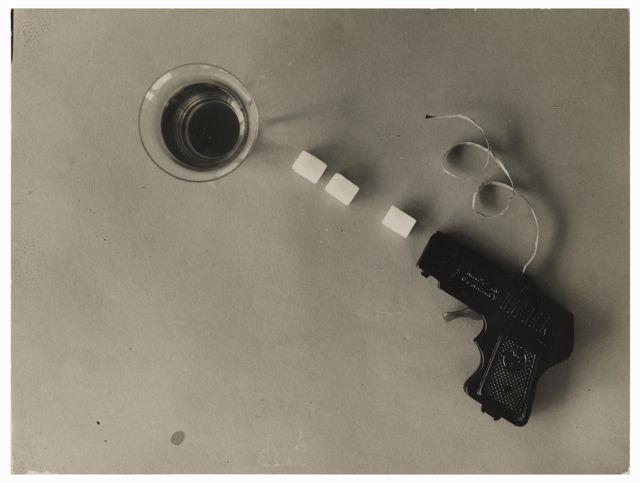 Photographic study with toy pistol and sugar cubes, Photo: Etel Fodor-Mittag, 1928.